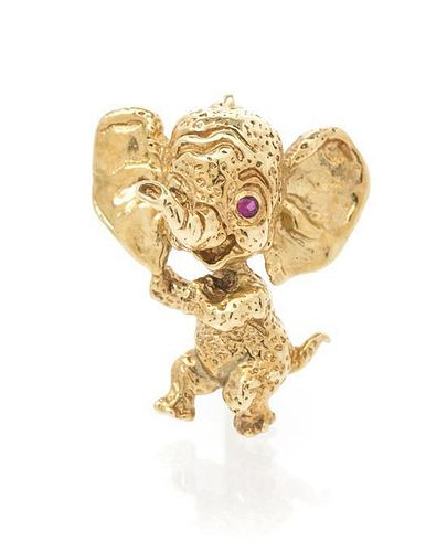 * A Retro 14 Karat Yellow Gold and Ruby Elephant Pin, Ruser, 2.44 dwts.
