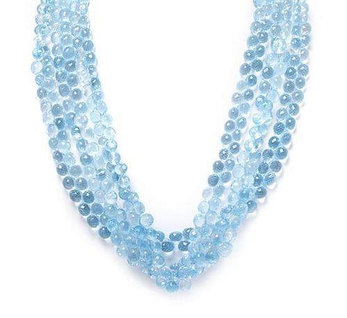 * An 18 Karat White Gold, Diamond and Blue Topaz Multi Strand Necklace,