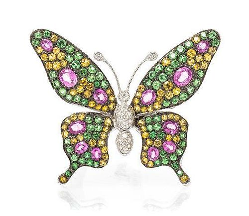 * An 18 Karat White Gold, Diamond and Multi Gem Butterfly Brooch, 13.00 dwts.