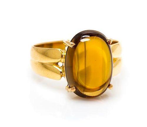 * A 14 Karat Yellow Gold and Enstatite Ring, 4.60 dwts.