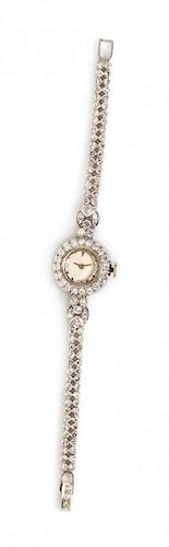 A Platinum and Diamond Wristwatch, Paul Vallette, 17.60 dwts.