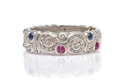 A Platinum, Sapphire and Ruby Ring, Alex Sepkus, 9.30 dwts.