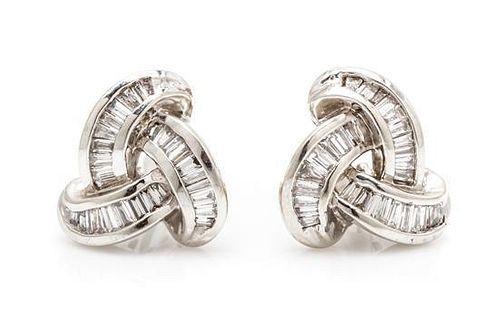 A Pair of 18 Karat White Gold and Diamond Earclips, 4.60 dwts.