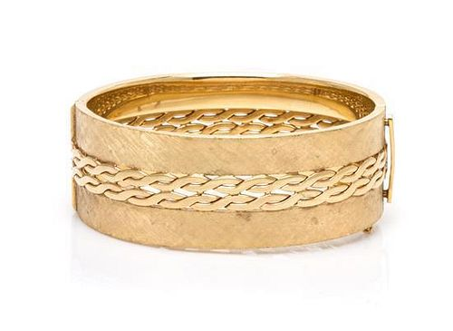 A 14 Karat Yellow Gold Bangle Bracelet, 23.80 dwts.
