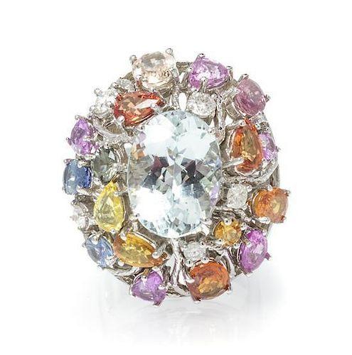 A 14 Karat White Gold, Aquamarine, Sapphire and Diamond Ring, 10.10 dwts.
