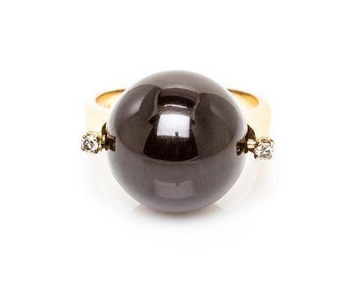 A 14 Karat Yellow Gold, Onyx and Diamond Ring, 4.90 dwts.