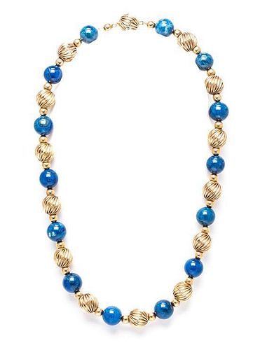 A 14 Karat Yellow Gold and Sodalite Bead Necklace, 21.10 dwts.
