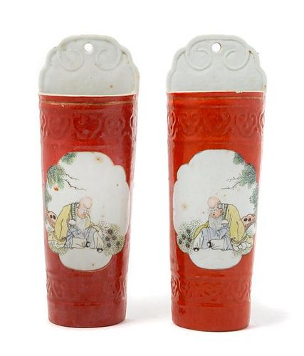 A Pair of Chinese Iron Red Ground Famille Rose Wall Vases Height of each 10 1/2 inches.