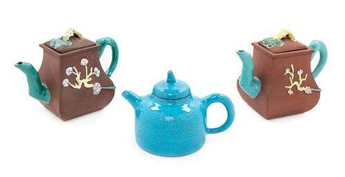 Three Chinese Yixing Pottery Teapots Height of tallest 5 1/2 inches.