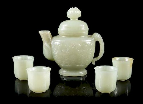 A Chinese Celadon Jade Teapot and Four Jade Teacups Height 4 1/4 inches.