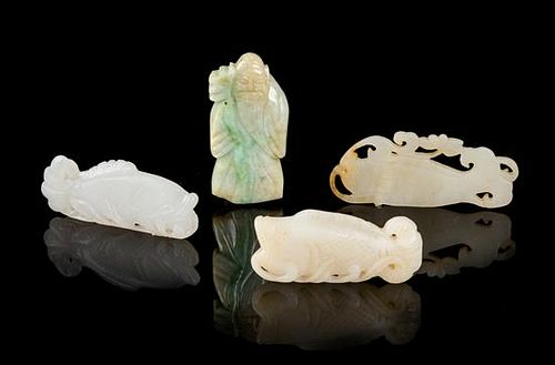 Four Chinese Jade and Jadeite Pendants Length of largest 2 1/2 inches.