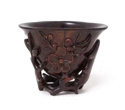 A Chinese Carved Wood Libation Cup Height 3 inches.