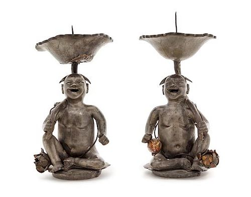 A Pair of Chinese Pewter Figural Form Candle Holders Height of each 8 1/4 inches.