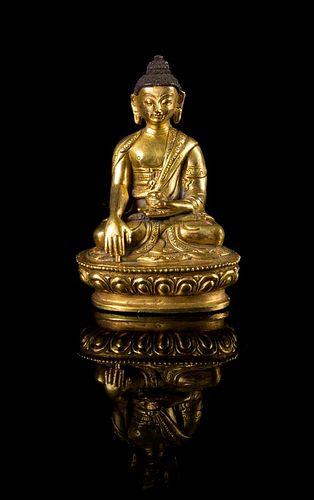 A Small Sino-Tibetan Gilt Bronze Figure of Buddha