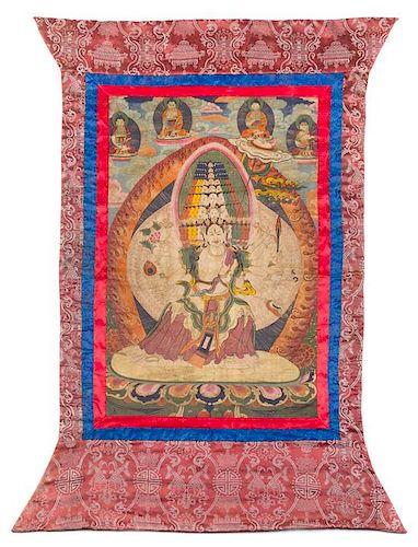 A Tibetan Thangka 30 1/2 x 19 1/2 inches (image).
