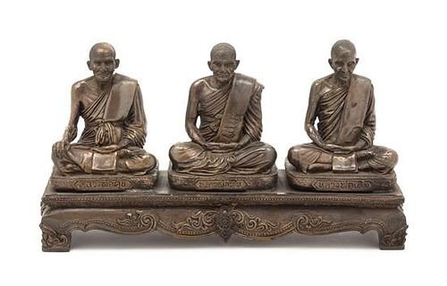 A Thai Bronze Figural Group Height 5 inches.