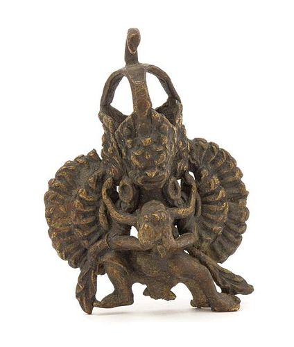 An Indian Brass Figure of Durga Height 3 inches.