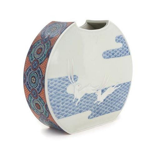 A Japanese Polychrome and Underglaze Blue Porcelain Vase Height 9 inches.