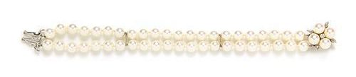 * A 14 Karat White Gold, Diamond and Cultured Pearl Double Strand Bracelet,