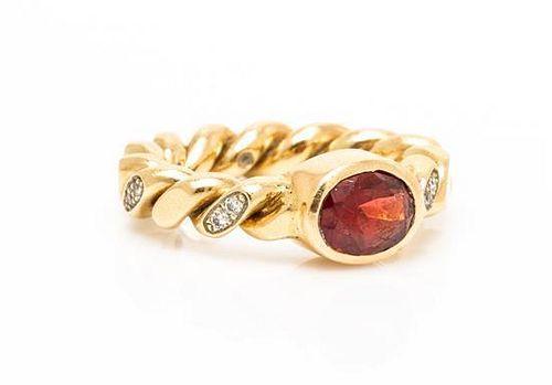 A 14 Karat Yellow Gold, Garnet and Diamond Ring, M&J Savitt, 6.00 dwts.