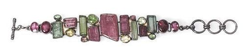 * A Sterling Silver and Multi Color Tourmaline Bracelet, Starborn, 40.40 dwts.