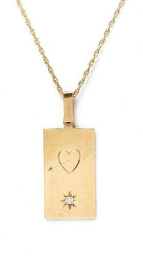 * A 14 Karat Yellow Gold and Diamond Pendant, 3.50 dwts.