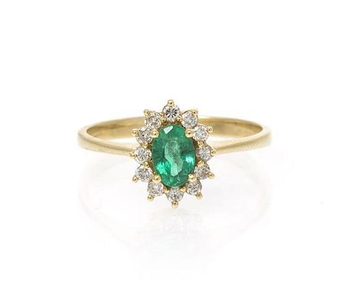 A 14 Karat Yellow Gold, Emerald and Diamond Ring, 1.50 dwts.