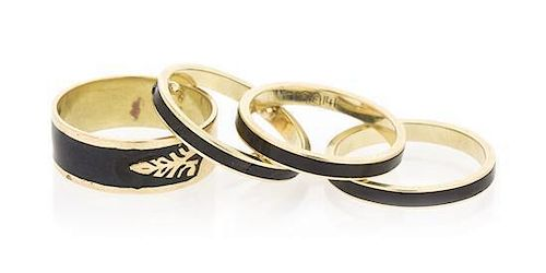 A Collection of Yellow Gold and Black Enamel Rings, 5.90 dwts.