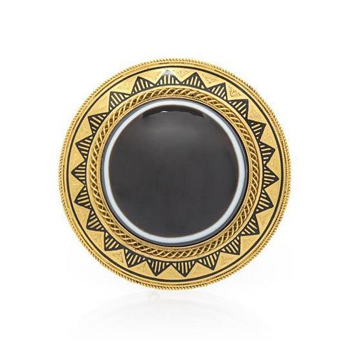 An Antique Yellow Gold, Banded Onyx and Enamel Mourning Brooch, 14.80 dwts.