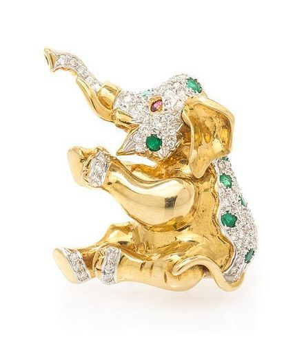* An 18 Karat Yellow Gold, Diamond, Emerald and Ruby Articulated Elephant Pendant/Brooch, 12.10 dwts.