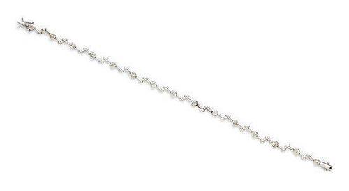 A 14 Karat White Gold and Diamond Bracelet, 3.80 dwts.