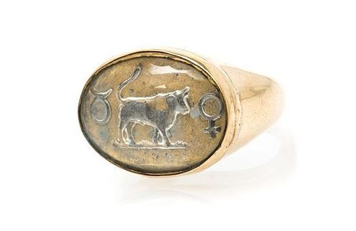 * An Antique Yellow Gold and Essex Crystal Zodiac Symbol Ring, 10.30 dwts.
