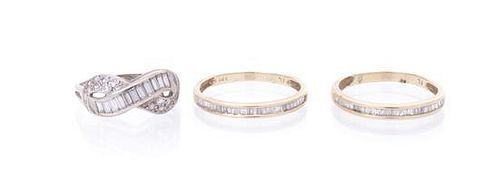 A Group of 14 Karat Gold and Diamond Rings, 3.70 dwts.