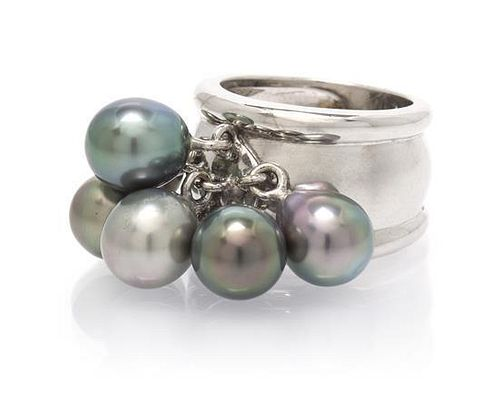 * An 18 Karat White Gold and Cultured Pearl Ring, 15.90 dwts.