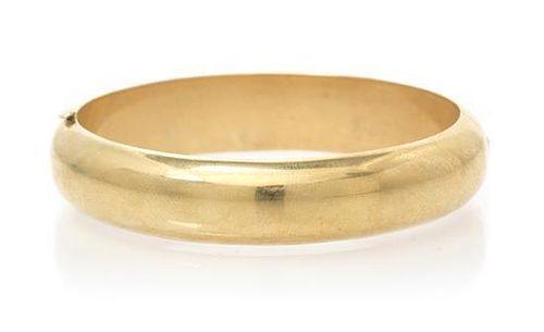 A 14 Karat Yellow Gold Bangle Bracelet, 19.40 dwts.
