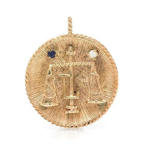 * A 14 Karat Yellow Gold Scales of Justice Pendant, 8.90 dwts.