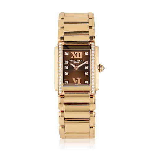 Patek Philippe Twenty~4 18K Rose Gold Diamond Ladies Watch, ref. 4910/11R-010