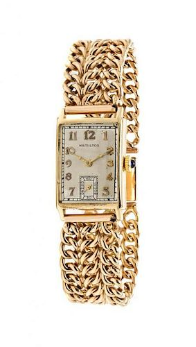 A 14 Karat Yellow Gold Wristwatch, Hamilton 28.40 dwts.