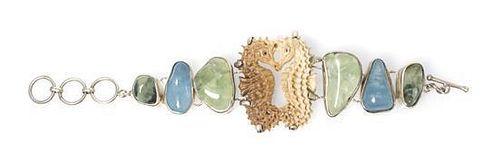 * A Sterling Silver, Quartz, Aquamarine and Vegetable Ivory Bracelet, 45.80 dwts.