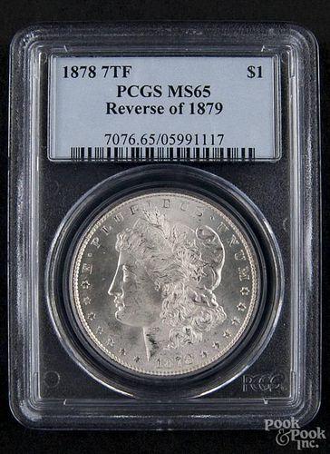 Silver Morgan dollar coin, 1878 7 TF, reverse of 1879, PCGS MS-65.