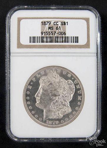 Silver Morgan dollar coin, 1879 CC, NGC MS-61.