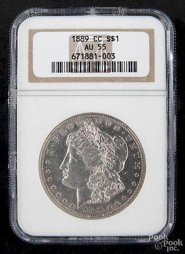 Silver Morgan dollar coin, 1889 CC, NGC AU-55.