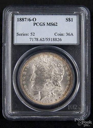 Silver Morgan dollar coin, 1887/ 6 O, PCGS MS-62.