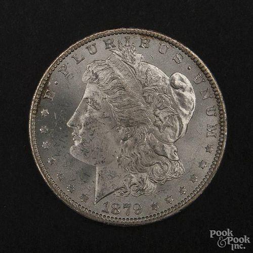 Silver Morgan dollar coin, 1879 O, MS-63 to MS-64.