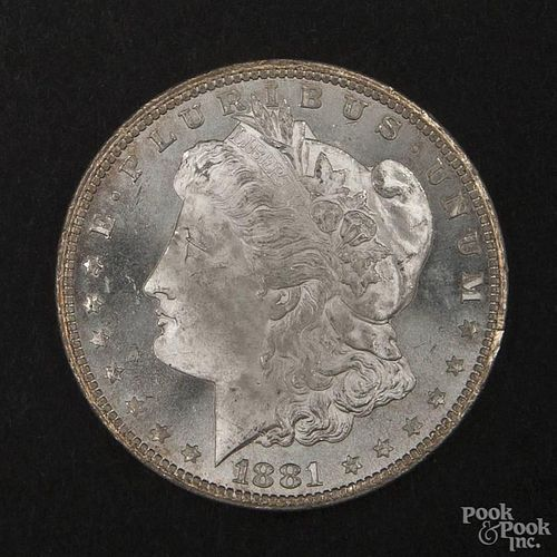 Silver Morgan dollar coin, 1881 CC, MS-64 to MS-65.