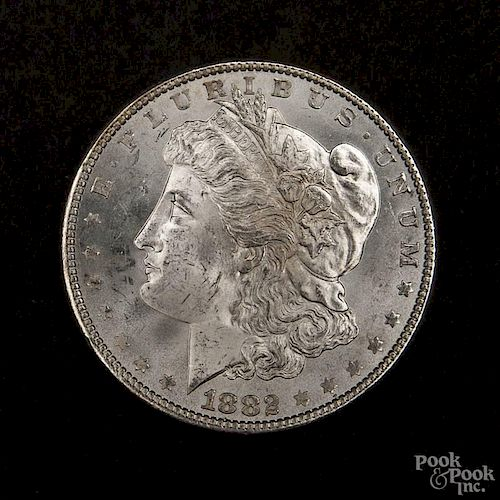 Silver Morgan dollar coin, 1882, MS-63 to MS-64.