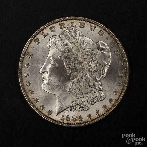 Silver Morgan dollar coin, 1884, MS-63 to MS-64.