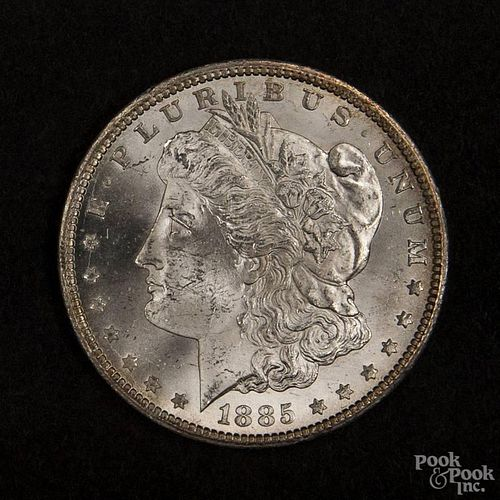 Silver Morgan dollar coin, 1885 CC, MS-63 to MS-64.