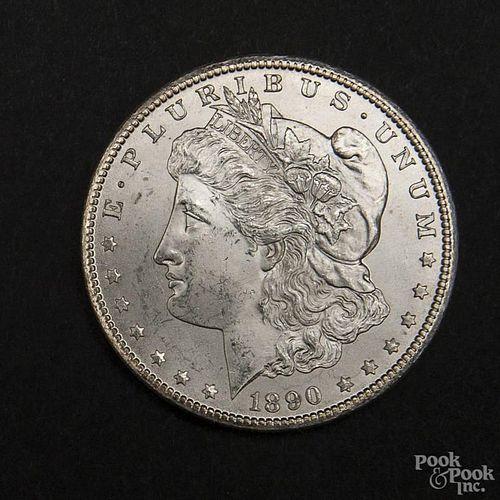 Silver Morgan dollar coin, 1890 CC, MS-63 to MS-64.
