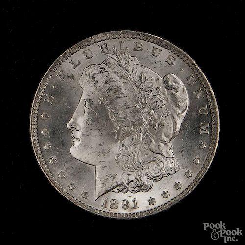 Silver Morgan dollar coin, 1891 CC, MS-63 to MS-64.